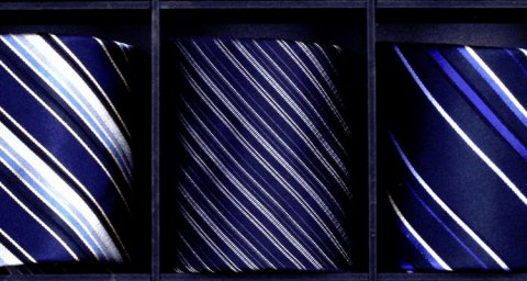 The lack of a tie becomes a symbol of organizational change